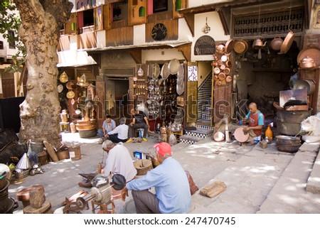 FEZ, MAROCCO - JUNE 24: fez ancient city market place around the souk june 24, 2013 in Fez, Marocco - stock photo