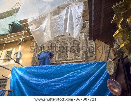 Fez, Morocco - December 14, 2015: Laborers working on rehab of Fez El Bali Medina. Fez, Morocco. North Africa. - stock photo
