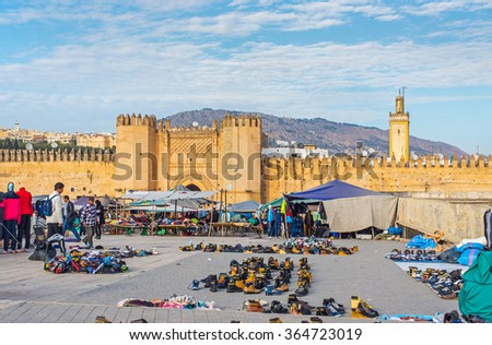 Fez, Morocco - December 14, 2015:  Market in Bab Chorfa at sunset, view from Bou Jeloud square. Bab Chorfa is a gate to ancient Fez El Bali Medina. Fez, Morocco. North Africa. - stock photo