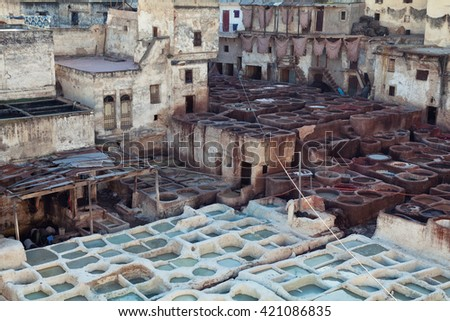 Fez, Morocco - March 6, 2015 : Traditional leather tannery. The Chouwara tanneries are Fez medina's most iconic sights and smells. - stock photo