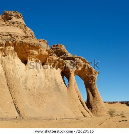 Fezzi Jaren Arch - Huge natural rock arch - Akakus (Acacus) Mountains, Sahara, Libya - stock photo