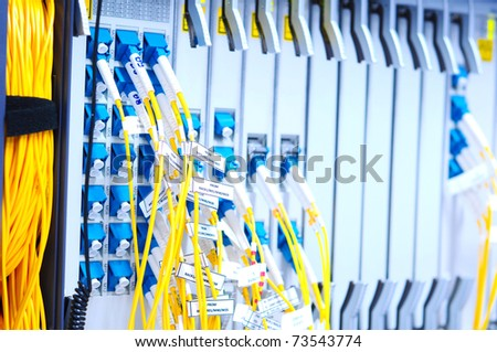 fiber and hardware in data center - stock photo