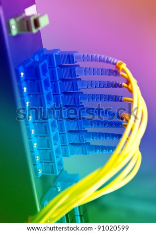 fiber cables and hub in data center - stock photo