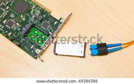 Fiber channel card with gigabit interface converter and optical cable - stock photo