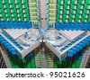 fiber optic cable management system with green and blue SC connectors - stock photo