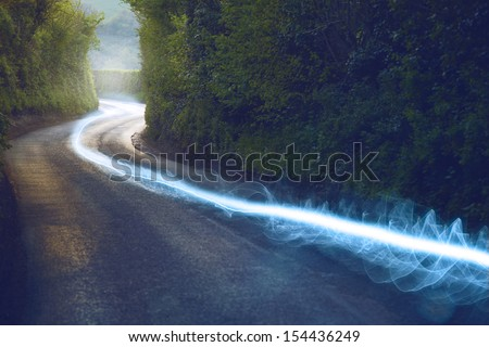 Fiber optic cable running above ground in the British Countryside - stock photo