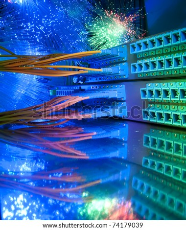 fiber optical network cable   and servers in a technology data center - stock photo