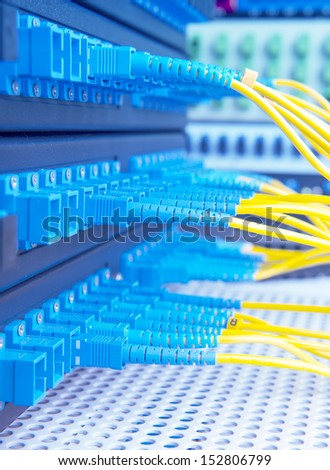 fiber optical network hub and cables - stock photo