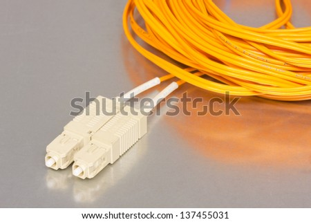 Fiber optics cable in a coil - stock photo