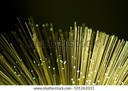 Fiber optics close-up, modern computer communication technology - stock photo