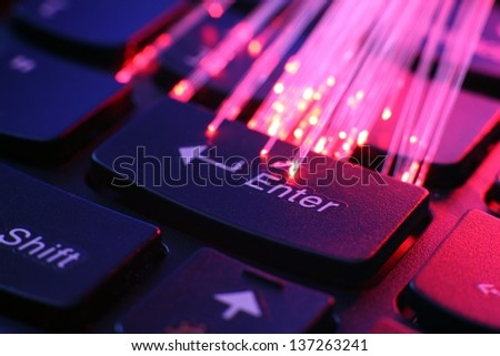 FIber optics on keyboard - stock photo