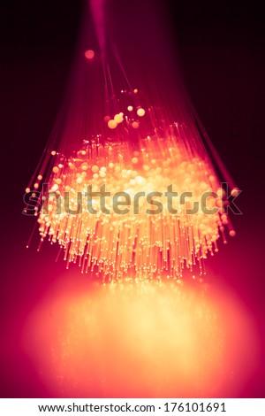 fiber optics purple light background - stock photo