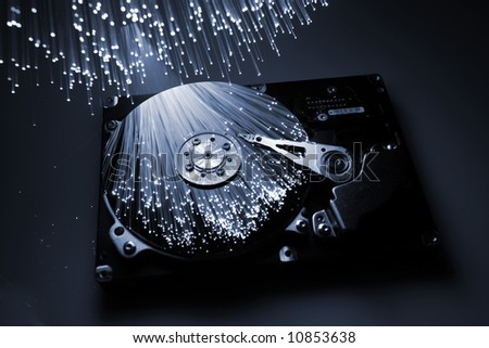 fibre optical and computer harddisk - stock photo