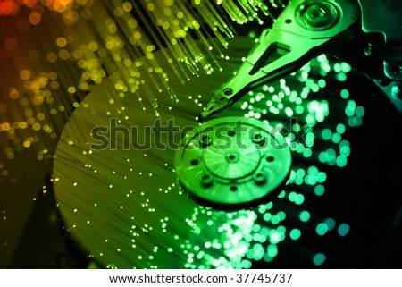 fibre optical and computer harddisk - stock photo