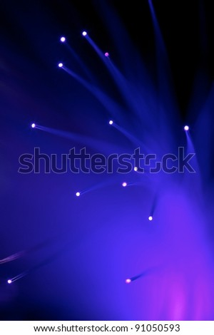 Fibre optics isolated against a black background - stock photo