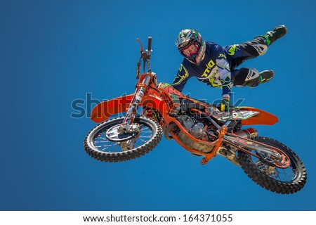 FICKSBURG, SOUTH AFRICA - NOVEMBER 23 : unidentified rider giving a free style motorcross acrobatics demonstration as part of Cherry Festival on November 23, 2013 in Ficksburg, South Africa - stock photo