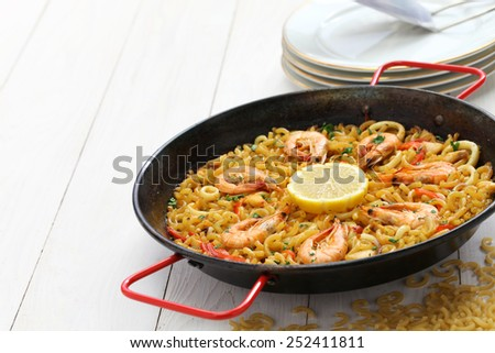 fideua de marisco, seafood pasta paella, spanish cuisine - stock photo