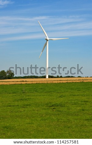 field and wind turbine generating electricity