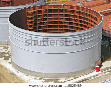 Field construction of a tank with scaffold inside - stock photo