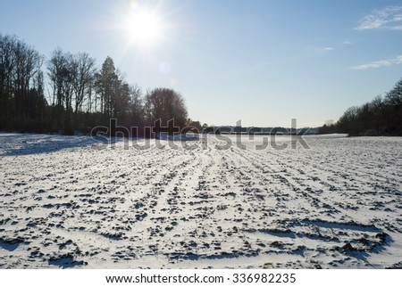 Field covered with snow in winter sunshine, Norway - stock photo