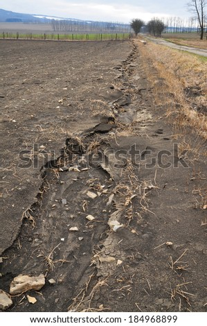 Field erosion, soil waste, environment - stock photo