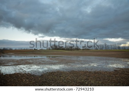 Field flooded by spring rain - stock photo