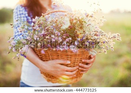 field flowers in the wicker basket