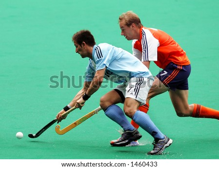 Field hockey match Argentina against Netherland (right) - stock photo