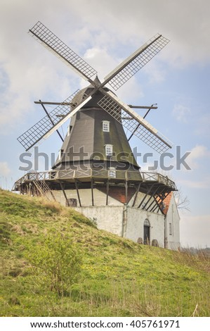 field in spring with windmill