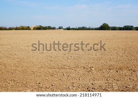 Field of dry ground - stock photo