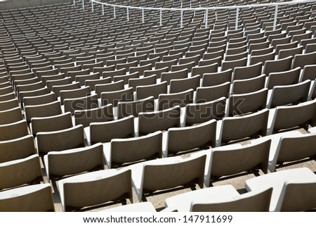 Field of empty stadium seats - stock photo
