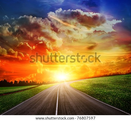 field of grass and perfect sunset sky - stock photo