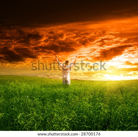 field of grass and young man