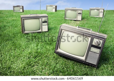 field of grass with tv's - stock photo