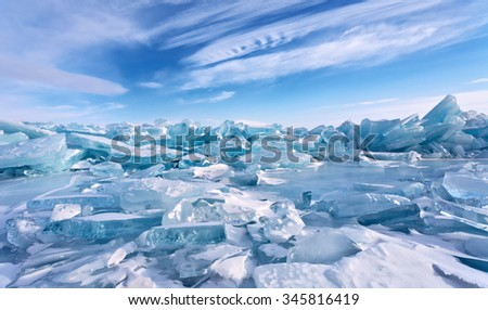 Field of ice hummocks on the frozen Lake Baikal - stock photo
