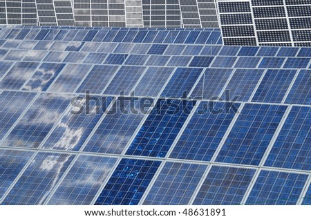 Field of solar collectors - ecology for alternative power - stock photo