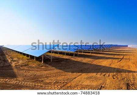 Field of solar panels under construction - stock photo