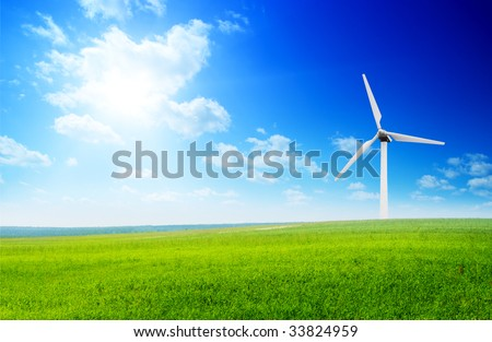 field of summer green grass and windmills - stock photo
