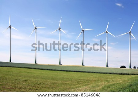 Field with a row of Wind Turbines - stock photo