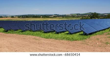 Field with black solar panels. - stock photo