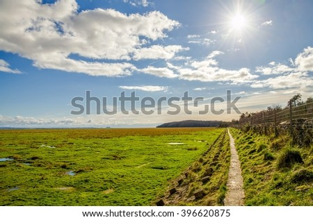Fields along coast, Grange-over-sands, Cumbria, England  - stock photo
