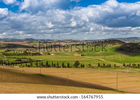 fields, hills, agriculture in Tuscany (Italy)