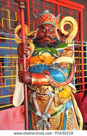 Fierce Looking Door God At A Chinese Temple