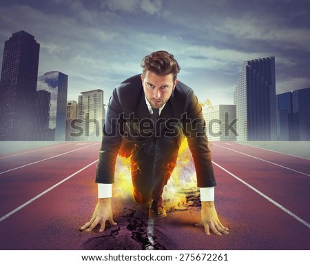 Fiery and determined businessman ready to compete - stock photo