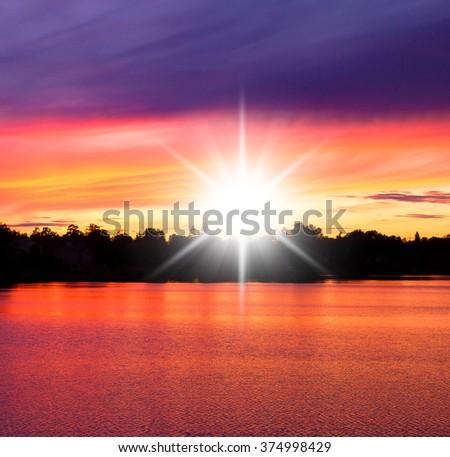 Fiery Backdrop Setting Sun  - stock photo