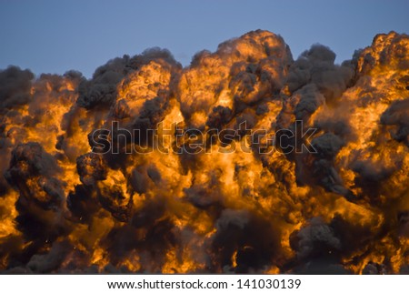 Fiery explosion with thick black smoke on an airport runway. - stock photo