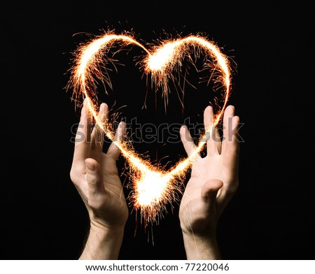 fiery heart of a person's palm. - stock photo