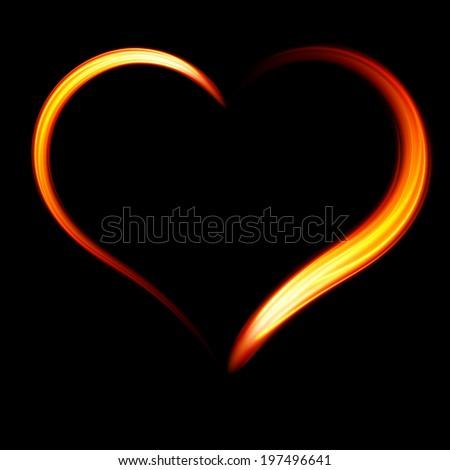 Fiery heart on a black background.  - stock photo