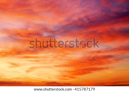 Fiery orange and red sunset sky. Beautiful sky background - stock photo