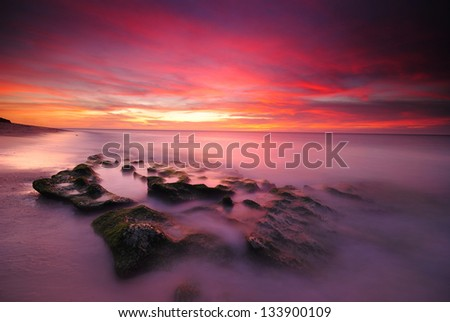 Fiery skies above Southern Finland at autumn. - stock photo